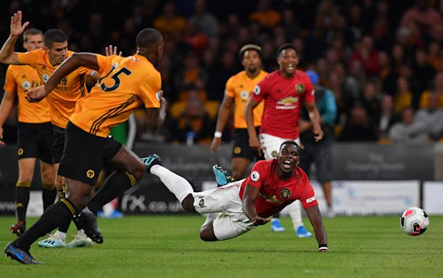 Conor Coady brings down Paul Pogba for United's penalty. (Credit: Getty Images)