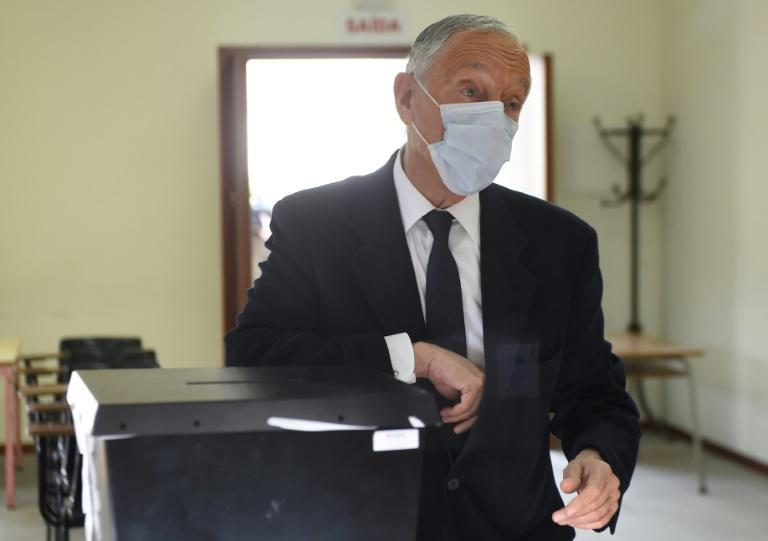 President Marcelo Rebelo de Sousa casting his vote at a polling station in northern Portugal for an election which is expected to hand him a second term