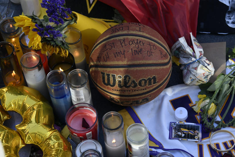 Fans continue to pay their respects to Kobe Bryant and his daughter Gianna, 13, at a memorial set up outside of Staples Center on January 28, 2020 in Los Angeles, California. Kobe his daughter Gianna, were among nine people killed in a helicopter crash on January 26 in Calabasas, California. (Photo by Kevork Djansezian/Getty Images)