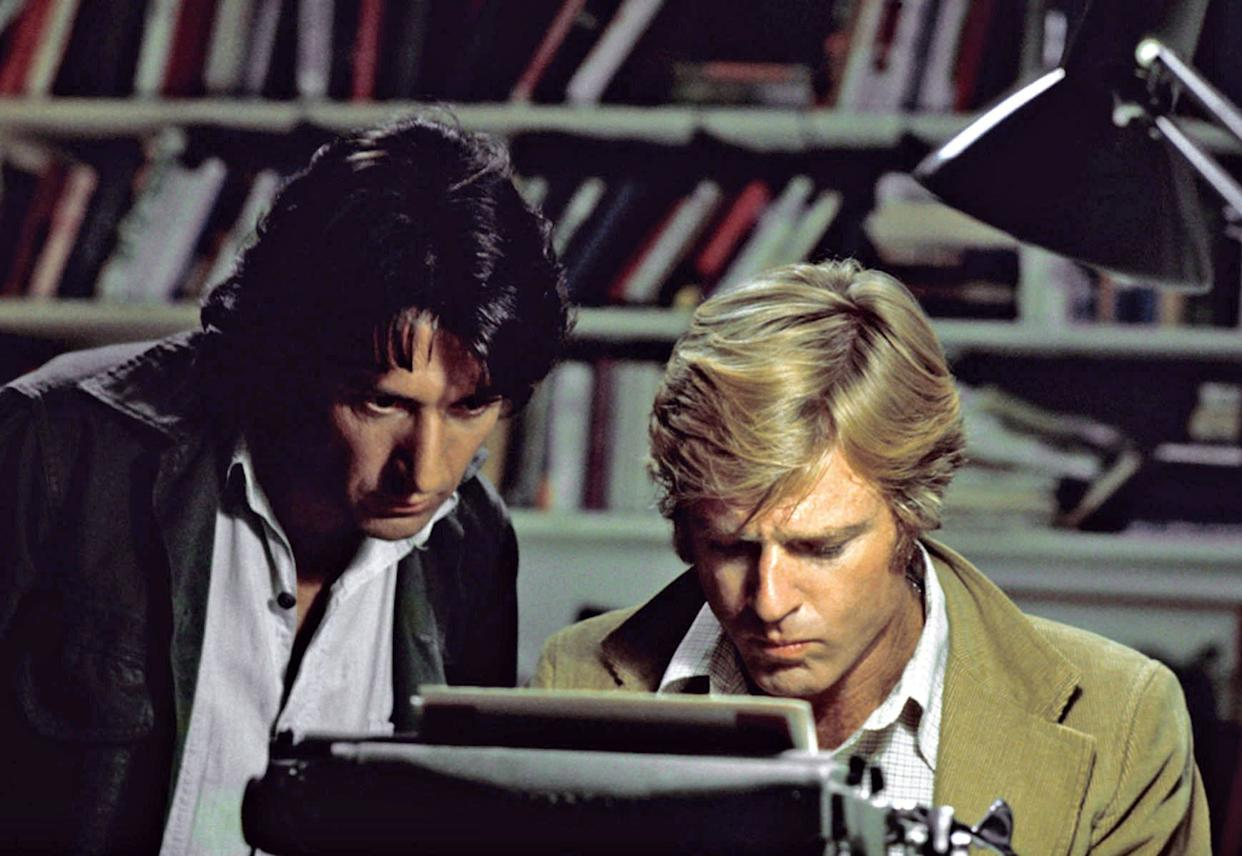 """In this file photo provided by Warner Bros., actors Robert Redford, right, and Dustin Hoffman appear in their roles as reporters Bob Woodward and Carl Bernstein, respectively, in the 1976 film """"All the President's Men."""" Personal details about the film and Watergate enliven a Discovery network documentary, """"All the President's Men Revisited"""" which airs Sunday at 8 p.m. ET. (AP Photo/Warner Bros., file)"""