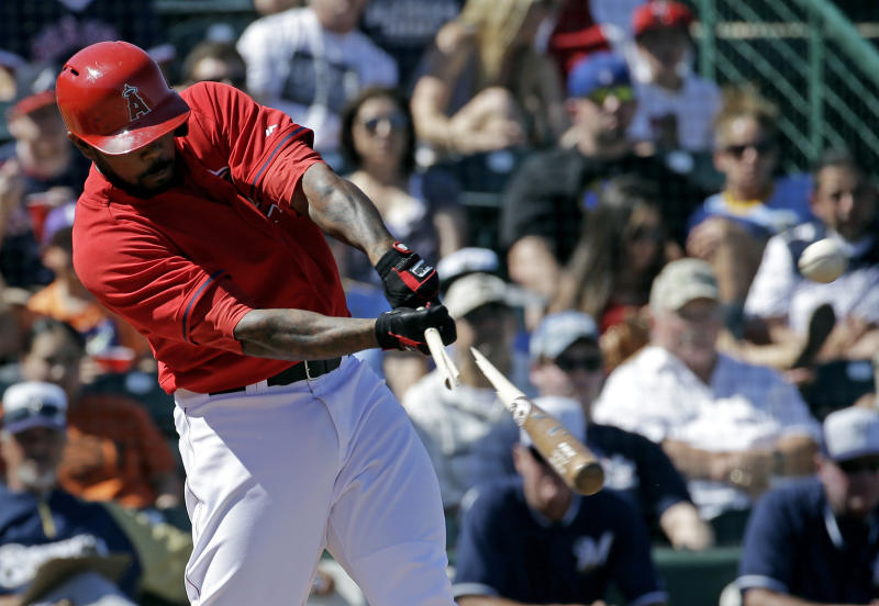 Los Angeles Angels' Howie Kendrick breaks his bat as he hits a sacrifice fly during the second inning of an exhibition spring training baseball game against the Milwaukee Brewers on Wednesday, March 12, 2014, in Tempe, Ariz. (AP Photo/Morry Gash)