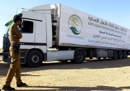 A Saudi security personnel stands next to a truck loaded with aid offered by King Salman Center for Relief and Humanitarian Aid to be sent to the Yemeni people, in Riyadh April 17, 2016. REUTERS/Faisal Al Nasser
