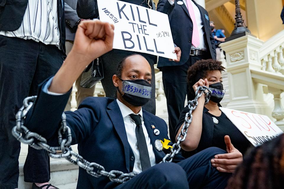 Demonstrators wear chains while holding a sit-in inside of the Capitol building in opposition of House Bill 531 on March 8, 2021 in Atlanta, Georgia. (Megan Varner/Getty Images)