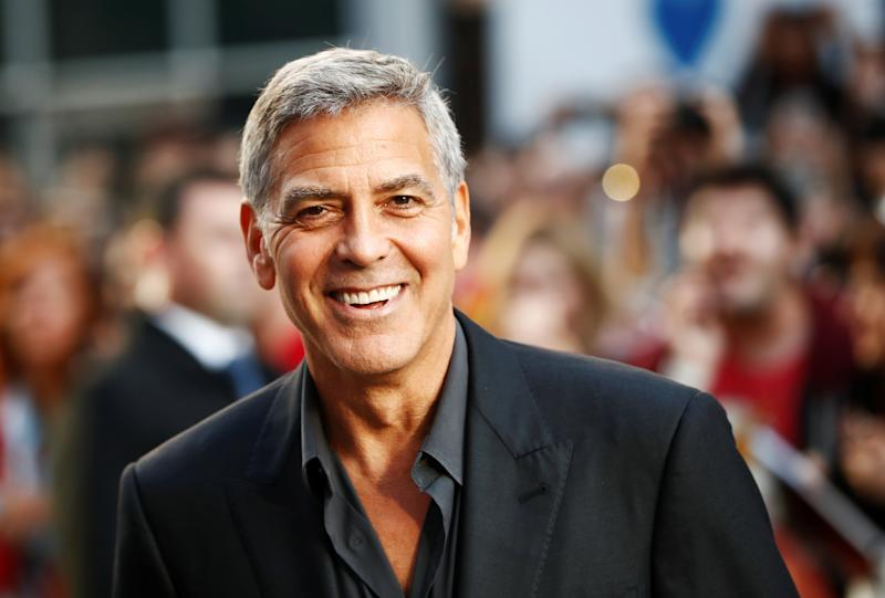 George Clooney managed to walk away from a scary scooter crash on the island of Sardinia.  (Mark Blinch / Reuters)