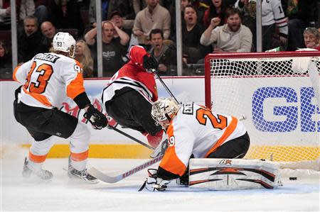 Dec 11, 2013; Chicago, IL, USA; Philadelphia Flyers goalie Ray Emery (29) fails to make a save on a goal scored by Chicago Blackhawks center Michal Handzus (26) during the second period at the United Center. Rob Grabowski-USA TODAY Sports