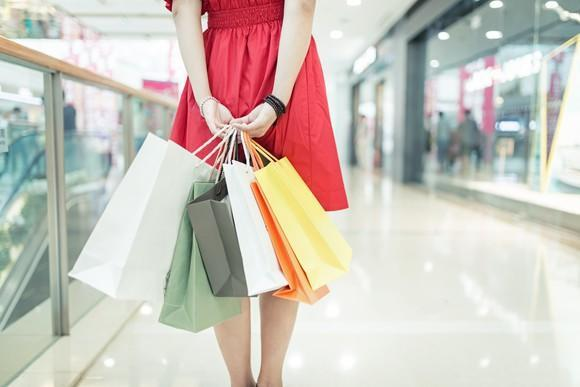 A woman shops in a mall.