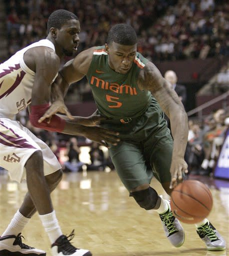 Miami's Dequan Jones, right, tries to get around the defense of Florida State's Okaro White in the first half of an NCAA college basketball game on Saturday, Feb. 11, 2012 in Tallahassee, Fla.(AP Photo/Steve Cannon)