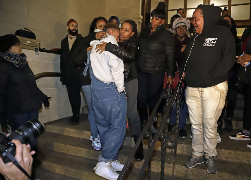 Supporters of Antwon Rose II, stand on the steps of Allegheny County Courthouse after hearing the verdict of not guilty on all charges for Michael Rosfeld, a former police officer in East Pittsburgh, Pa., Friday, March 22, 2019. Rosfeld was charged with homicide in the fatal shooting of Antwon Rose II as he fled during a traffic stop on June 19, 2018. (AP Photo/Gene J. Puskar)