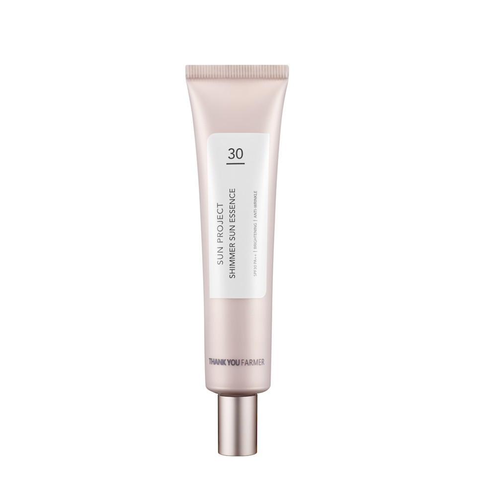 """You can <a href=""""https://www.allure.com/gallery/best-korean-sunscreen?mbid=synd_yahoo_rss"""" rel=""""nofollow noopener"""" target=""""_blank"""" data-ylk=""""slk:thank K-beauty"""" class=""""link rapid-noclick-resp"""">thank K-beauty</a> for Thank You Farmer's Sun Project Shimmer Sun Essence SPF 30, which looks and feels more like a <a href=""""https://www.allure.com/review/vdl-lumilayer-primer?mbid=synd_yahoo_rss"""" rel=""""nofollow noopener"""" target=""""_blank"""" data-ylk=""""slk:luminous primer"""" class=""""link rapid-noclick-resp"""">luminous primer</a> than a sunscreen. The formula is thin, glides on easily, and is laced with hydrating shea butter and spot-brightening niacinamide. Honestly, our only qualm is the frustration of wanting to simultaneously drench ourselves in it and conserve it for as long as possible."""