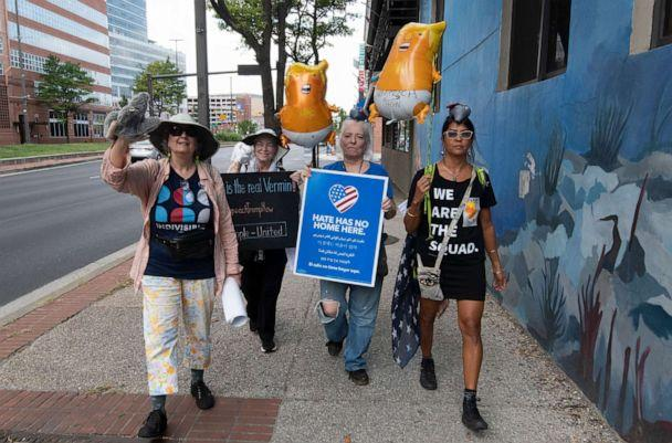 PHOTO: Protesters walk down the street towards the eastern edge of the Inner Harbor before President Donald Trump speaks in Baltimore, Sept. 12, 2019. (Tommy Gilligan/AP)