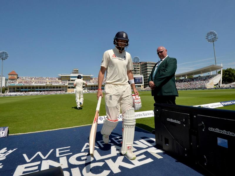 The England captain makes his way off the pitch after being dismissed (Getty)