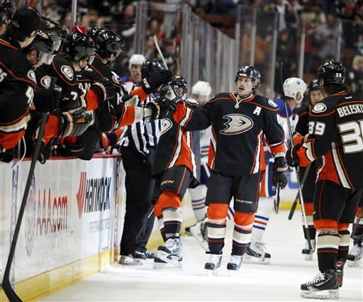Anaheim Ducks right wing Teemu Selanne celebrates with teammates after scoring a goal against the Edmonton Oilers in the first period of an NHL hockey game in Anaheim, Calif., Sunday, April 1, 2012. (AP Photo/Christine Cotter)