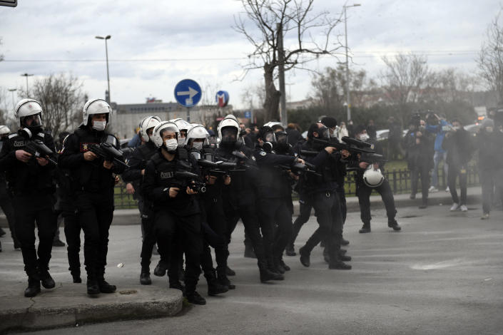 Turkish police officers fire rubber bullets and tear gas at students of the Bogazici University, protesting the appointment of a government loyalist to head their university, during clashes in Istanbul, Tuesday, Feb. 2, 2021. For weeks, students and faculty at Istanbul's prestigious Bogazici University have been protesting President Recep Tayyip Erdogan's appointment of Melih Bulu, a figure who has links to his ruling party, as the university's rector. They have been calling for Bulu's resignation and for the university to be allowed to elect its own president. (AP Photo/Omer Kuscu)