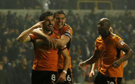 Soccer Football - Championship - Wolverhampton Wanderers vs Derby County - Molineux Stadium, Wolverhampton, Britain - April 11, 2018 Wolves' Ruben Neves celebrates with Conor Coady after scoring their second goal Action Images/Andrew Boyers