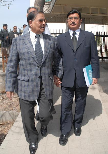 Former Pakistan army chief, retired General Mirza Aslam Beg, left, leaves the Supreme court with anunidentified lawyer after a hearing of Mehran Bank scandal in Islamabad, Pakistan on Friday, March 9, 2012. Pakistan's powerful military establishment is under rare scrutiny from the country's top court, which after a gap of 16 years has opened an investigation into allegations it funneled money to politicians in the 1990s to influence elections. (AP Photo/B.K. Bangash)