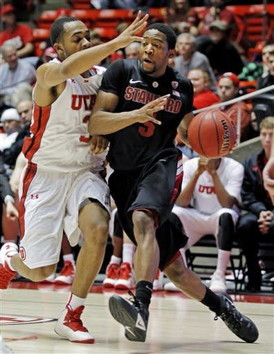 Stanford guard Chasson Randle (5) drives the baseline against Utah guard Justin Seymour (3) during the first half of an NCAA college basketball game, Sunday, Jan. 27, 2013, in Salt Lake City. (AP Photo/Steve C. Wilson)
