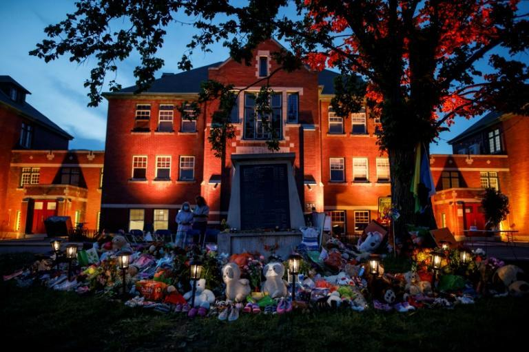 A makeshift memorial to honor the 215 children whose remains were discovered near the former Kamloops Indian Residential School in Kamloops, British Columbia, Canada, on June 2, 2021
