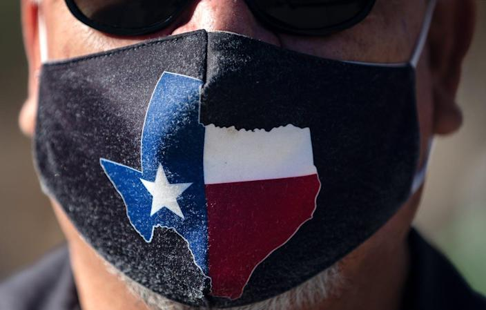 """<span class=""""caption"""">Texas' announced it is ending its COVID-19 restrictions. Its vaccination rate is among the lowest in the U.S., and its case numbers are still high.</span> <span class=""""attribution""""><a class=""""link rapid-noclick-resp"""" href=""""https://www.gettyimages.com/detail/news-photo/san-jose-hotel-engineering-manager-rocky-ontiveros-wears-a-news-photo/1231493646"""" rel=""""nofollow noopener"""" target=""""_blank"""" data-ylk=""""slk:Montinique Monroe/Getty Images"""">Montinique Monroe/Getty Images</a></span>"""