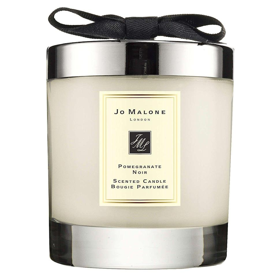 """<p><a rel=""""nofollow noopener"""" href=""""https://www.johnlewis.com/jo-malone-london-pomegranate-noir-home-candle-200g/p231745655"""" target=""""_blank"""" data-ylk=""""slk:BUY NOW"""" class=""""link rapid-noclick-resp"""">BUY NOW</a> <strong>John Lewis, £45 </strong></p><p>This Jo Malone housewarming gift will add a beautiful scent to any new home. If you're stuck on what to give, candles always make a great gift for the home. </p>"""