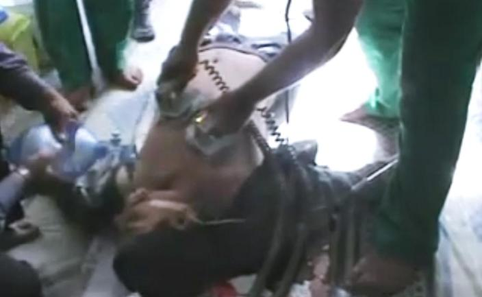 This image made from amateur video released by the Shaam News Network and accessed Thursday, June 21, 2012, purports to show a Syrian wounded man receiving help at a field hospital in Homs, Syria. A spokeswoman for the International Committee of the Red Cross says aid workers teams will try to evacuate wounded and sick civilians and those who want to leave rebel-held areas in the embattled central Syrian city of Homs. (AP Photo/Shaam News Network via AP video) TV OUT, THE ASSOCIATED PRESS CANNOT INDEPENDENTLY VERIFY THE CONTENT, DATE, LOCATION OR AUTHENTICITY OF THIS MATERIAL