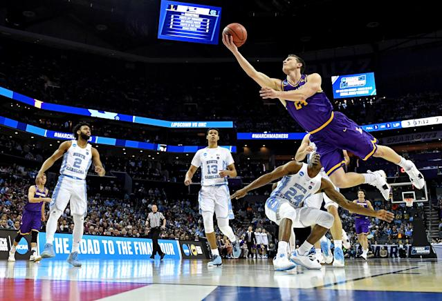 Mar 16, 2018; Charlotte, NC, USA; Lipscomb Bisons guard Garrison Mathews (24) shoots the ball against North Carolina Tar Heels guard Kenny Williams (24) during the first half in the first round of the 2018 NCAA Tournament at Spectrum Center. Mandatory Credit: Bob Donnan-USA TODAY Sports TPX IMAGES OF THE DAY