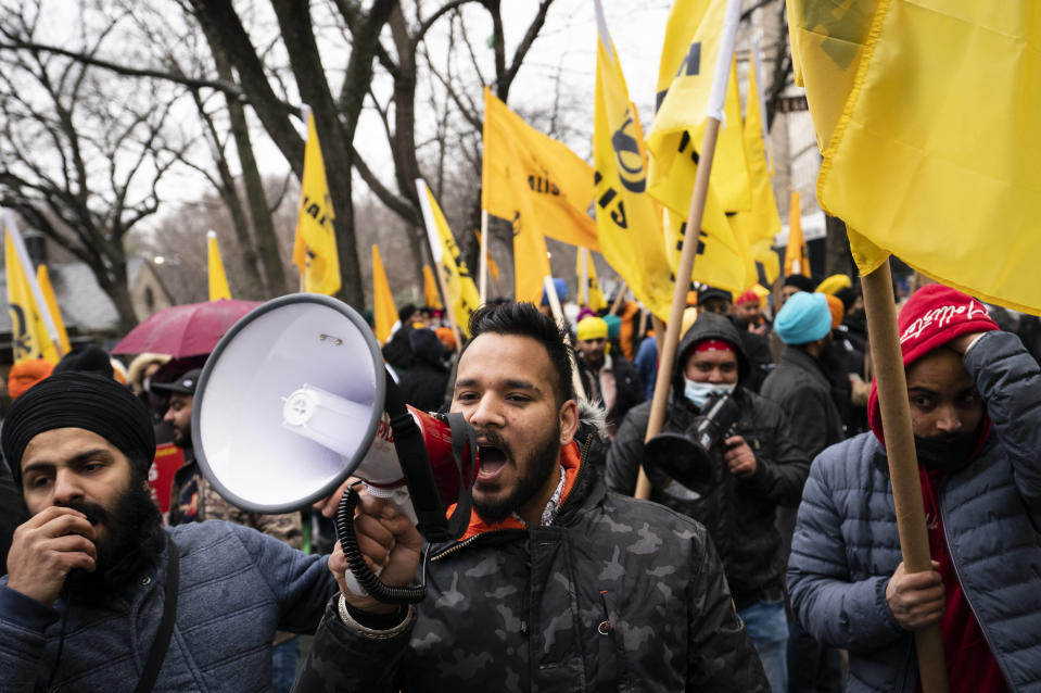 Protesters lead a chant on Fifth Avenue outside the Consulate General of India, Tuesday, Jan. 26, 2021, in the Manhattan borough of New York. Tens of thousands of protesting farmers have marched, rode horses and drove long lines of tractors into India's capital, breaking through police barricades to storm the historic Red Fort. The farmers have been demanding the withdrawal of new laws that they say will favor large corporate farms and devastate the earnings of smaller scale farmers. Republic Day marks the anniversary of the adoption of India's constitution on Jan. 26, 1950. (AP Photo/John Minchillo)