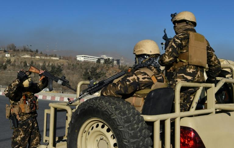 Afghan security personnel stand guard near the Intercontinental Hotel