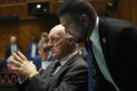 Rep. Andrés Cano, D-Tucson, right, speaks with Arizona House Speaker Rusty Bowers, R-Mesa, during a vote on the Arizona budget Thursday, June 24, 2021, in Phoenix. (AP Photo/Ross D. Franklin)