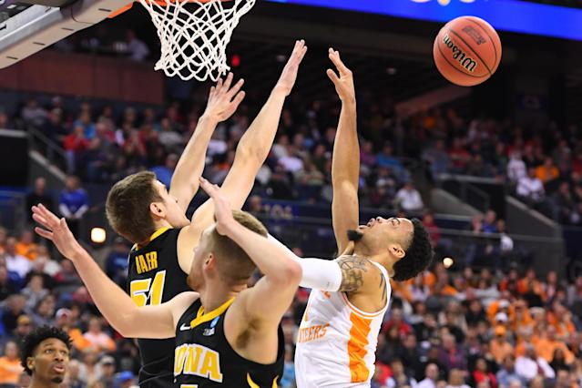 <p>Nicholas Baer #51 of the Iowa Hawkeyes knocks the ball away from Lamonte Turner #1 of the Tennessee Volunteers in the second round of the 2019 NCAA Men's Basketball Tournament held at Nationwide Arena on March 24, 2019 in Columbus, Ohio. (Photo by Jamie Schwaberow/NCAA Photos via Getty Images) </p>