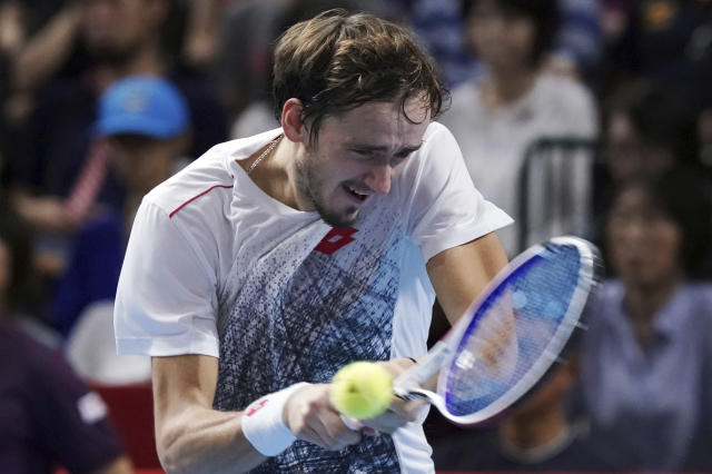 Daniil Medvedev of Russia returns a shot against Kei Nishikori of Japan during their single's final match at the Japan Open men's tennis tournament in Tokyo Sunday, Oct. 7, 2018. (AP Photo/Eugene Hoshiko)