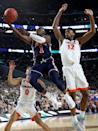 Jared Harper #1 of the Auburn Tigers drives to the basket against Kihei Clark #0 and De'Andre Hunter #12 of the Virginia Cavaliers in the first half during the 2019 NCAA Final Four semifinal at U.S. Bank Stadium on April 6, 2019 in Minneapolis, Minnesota. (Photo by Streeter Lecka/Getty Images)