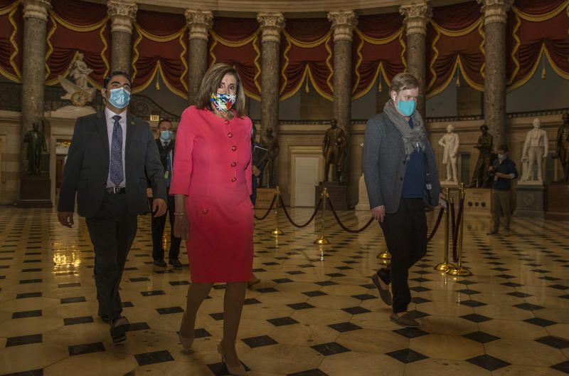 """House Speaker Nancy Pelosi walks towards the House Chamber at the Capitol, Monday, July 20, 2020, in Washington. Pelosi, who presided over a moment of silence for Georgia Rep. John Lewis, choked up Monday recalling their last conversation the day before he died. """"It was a sad one,"""" Pelosi said of their conversation Thursday. """"We never talked about his dying until that day."""" Lewis, 80, died Friday, several months after he was diagnosed with advanced pancreatic cancer. (AP Photo/Manuel Balce Ceneta)"""