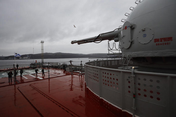 A view from on board the Northern Fleet's flagship, the Pyotr Veilikiy (Peter the Great) missile cruiser, with a ship's cannon on the right at its Arctic base of Severomorsk, Russia, Thursday, May 13, 2021. Adm. Alexander Moiseyev, the commander of Russia's Northern Fleet griped Thursday about increased NATO's military activities near the country's borders, describing them as a threat to regional security. (AP Photo/Alexander Zemlianichenko)