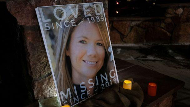 PHOTO: In this Dec. 13, 2018 file photo, a poster with the picture of missing Kelsey Berreth is propped up with candles for a vigil at Memorial Park in Woodland Park, Colo. (Kelsey Brunner/The Gazette via AP, FILE)