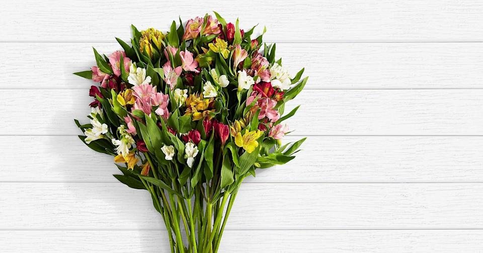 """<p>Rest the <a href=""""https://www.popsugar.com/buy/100-Blooms-Peruvian-444265?p_name=100%20Blooms%20of%20Peruvian&retailer=proflowers.com&pid=444265&price=40&evar1=casa%3Aus&evar9=46127505&evar98=https%3A%2F%2Fwww.popsugar.com%2Fhome%2Fphoto-gallery%2F46127505%2Fimage%2F46128443%2F100-Blooms-Peruvian&list1=shopping%2Cgift%20guide%2Cflowers%2Chouse%20plants%2Cplants%2Cmothers%20day%2Cgifts%20for%20women&prop13=api&pdata=1"""" class=""""link rapid-noclick-resp"""" rel=""""nofollow noopener"""" target=""""_blank"""" data-ylk=""""slk:100 Blooms of Peruvian"""">100 Blooms of Peruvian </a> ($40) on a dining table, and take in its vivid colors. </p>"""