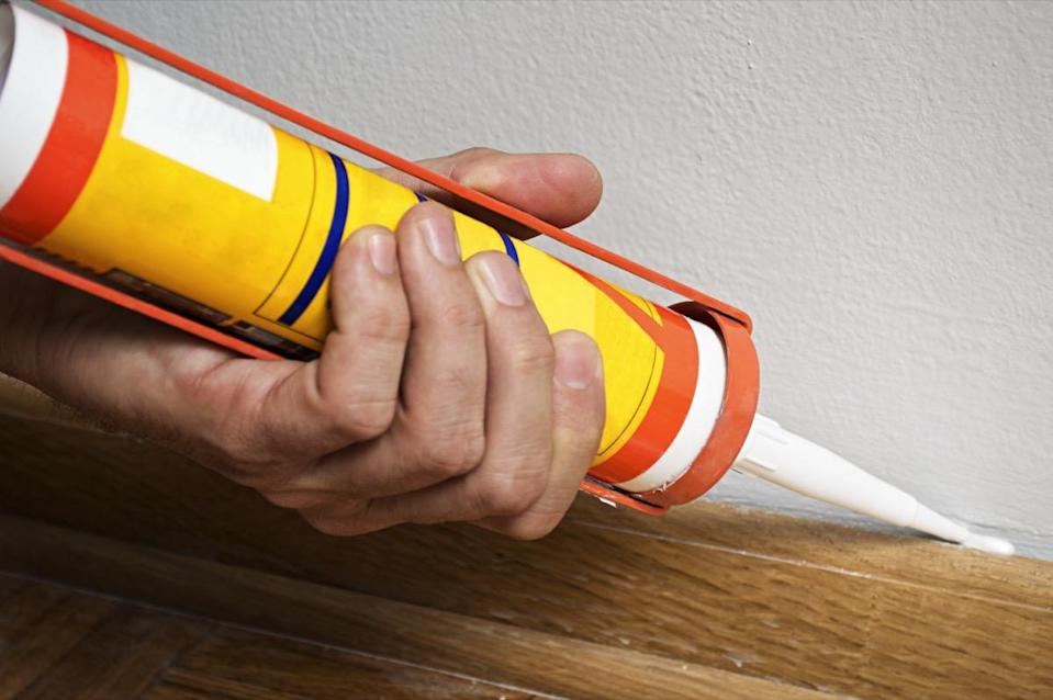 """And when it comes to cracks in your walls, it's important to use the right kind of caulk to repair them. """"Use latex caulking as it will not crack once dry or over time the way silicone will,"""" says Seed."""
