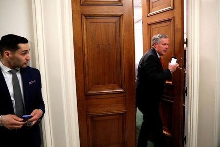 U.S. Representative Mark Meadows (R-NC) (R) is trailed by reporters as he walks between meetings at the U.S. Capitol in Washington. REUTERS/Jonathan Ernst