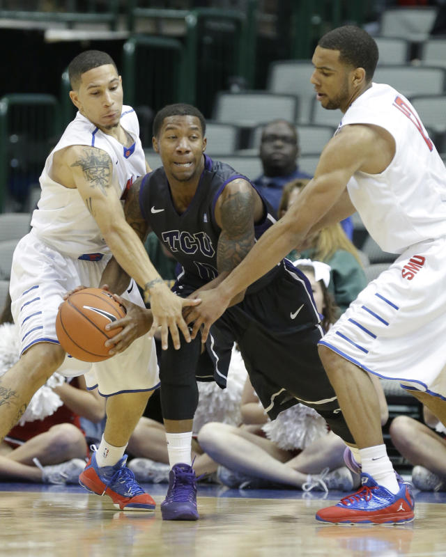 TCU guard Charles Hill, Jr., center, looks to pass against SMU defenders Nic Moore, left, and Nick Russell during the first half of an NCAA college basketball game in Dallas, Friday, Nov. 8, 2013. (AP Photo/LM Otero)