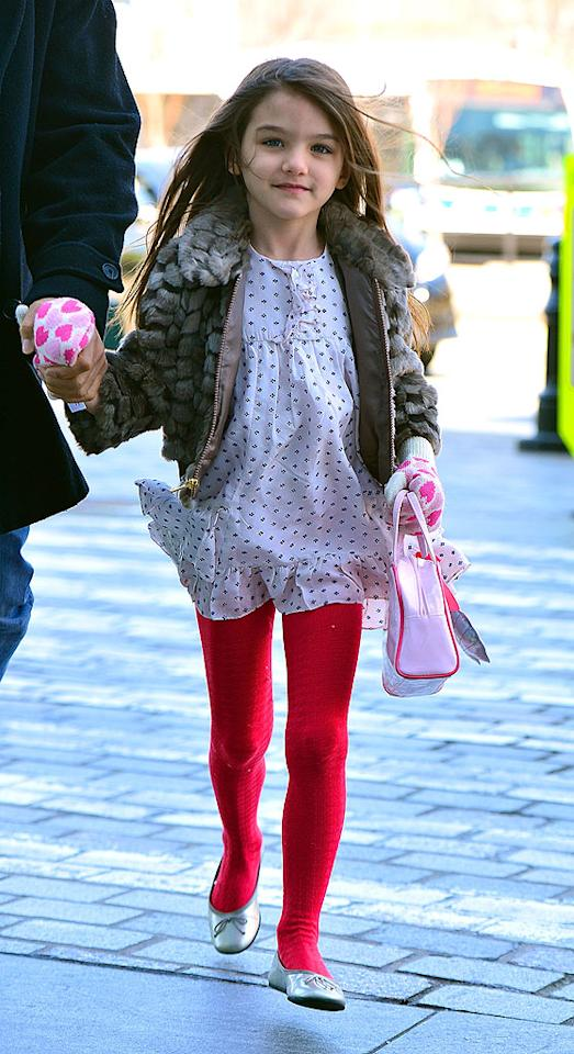 And just like her mama, little Suri made a few wardrobe changes throughout the day. This particular outfit featured cute red tights and mittens with hearts. But is that fur real? Hopefully not. Also, is it us, or is the 4-year-old walking on air? (3/27/2012)