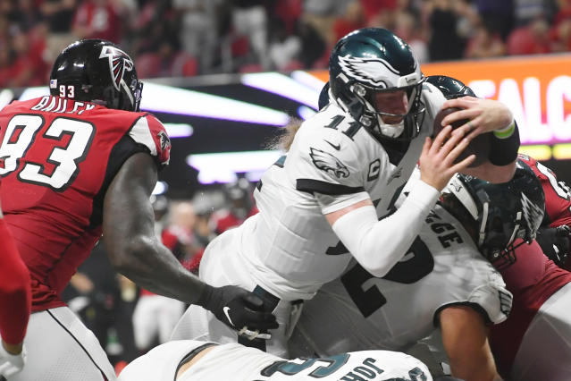 Philadelphia Eagles quarterback Carson Wentz (11) leaps into the end zome for a touchdown against the Atlanta Falcons during the second half of an NFL football game, Sunday, Sept. 15, 2019, in Atlanta. (AP Photo/John Amis)