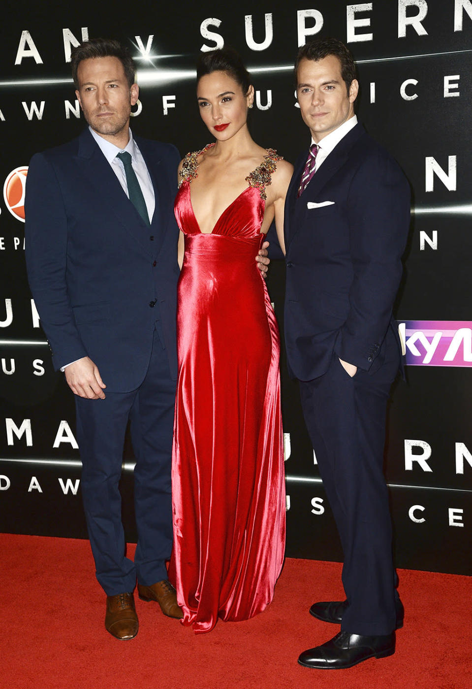 <p>Despite initial backlash for her casting, Gadot's Wonder Woman was praised by critics and fans as one of the best parts of Batman v Superman . Gadot and co-stars Affleck and Cavill stopped for a photo at the London premiere on March 22, 2016. (Photo: Dave J Hogan/Getty Images) </p>
