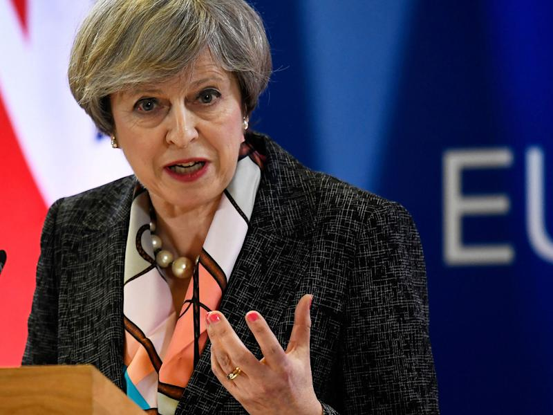 Theresa May attends a news conference during the EU Summit in Brussels: Reuters