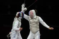 <p>Tokyo 2020 Olympics - Fencing - Women's Team Foil - Bronze medal match - Makuhari Messe Hall B - Chiba, Japan - July 29, 2021. Arianna Errigo of Italy in action against Sabrina Massialas of the United States REUTERS/Maxim Shemetov</p>