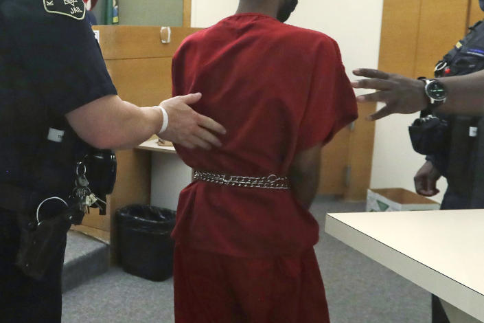 Dawit Kelete wears handcuffs chained to his waist as he walks out of a court appearance Monday, July 6, 2020, in Seattle. Kelete is accused of driving a car on to a closed Seattle freeway and hitting two protesters, killing one, over the weekend. Seattle has been the site of prolonged unrest over the death of George Floyd, a Black man who was in police custody in Minneapolis and had shut down the interstate for 19 days in a row. (AP Photo/Elaine Thompson)