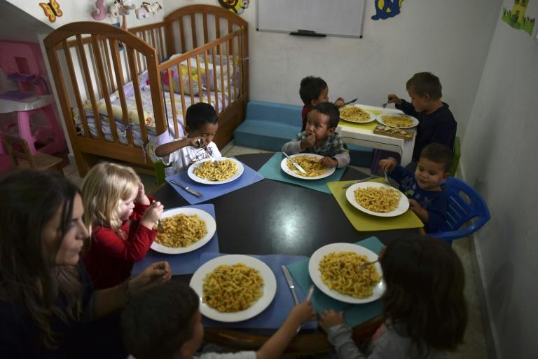 Children enjoy a meal at a shelter in Maracay, north-central Venezuela -- UNICEF estimates that the number of Venezuelan children in need of aid will more than double in 2019 to reach 1.1 million