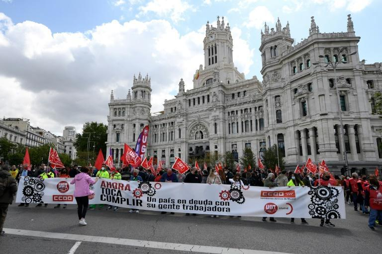 The Spanish marchers wore masks and observed social distancing