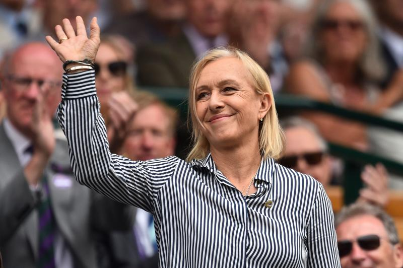 US former tennis player Martina Navratilova waves as she is presented in the Royal Box on Centre Court at The All England Tennis Club in Wimbledon.