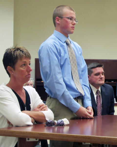 Tyler Pagenstecher, 18, center, listens in juvenile court, Monday, Oct. 22, 2012, in Lebanon, Ohio, as a judge sentences him to a minimum of six months in a juvenile jail stemming from his conviction on drug-trafficking charges. Pagenstecher is flanked by his mother, 50-year-old Daffney Pagenstecher, and his attorney, Mike O'Neill. Authorities say Pagenstecher played a major role in a southwestern Ohio drug ring that sold as much as $20,000 worth of high-grade marijuana a month to fellow students in and around his well-to-do suburb. (AP Photo/Amanda Myers)