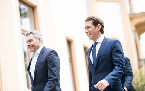 Austrian Chancellor Sebastian Kurz, of the Austrian People's Party, OEVP, right, arrives to address the media - Credit: Michael Gruber/AP