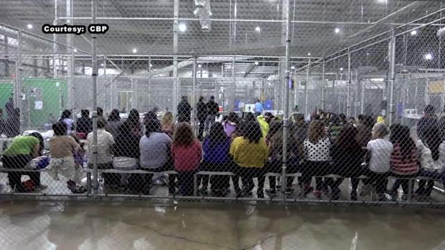 Hundreds of immigrant children are waiting in a series of cages created by metal fencing inside a McAllen processing center.